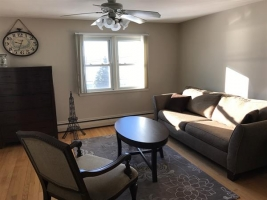 Sitting area in master bedroom.  Sofa pulls out to a queen size bed