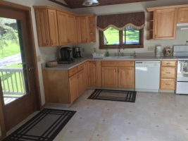 Bright kitchen with skylights. Modern appliances and maple cabinets. Brand new Bosch dishwasher.