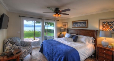 Master bedroom with king bed and stunning lake views