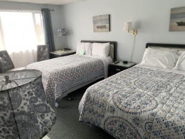 Room 10 with one double and one queen bed.  Adjoins with room 9 that has 2 double beds