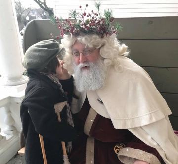 Tiny Tim speaking with Father Christmas