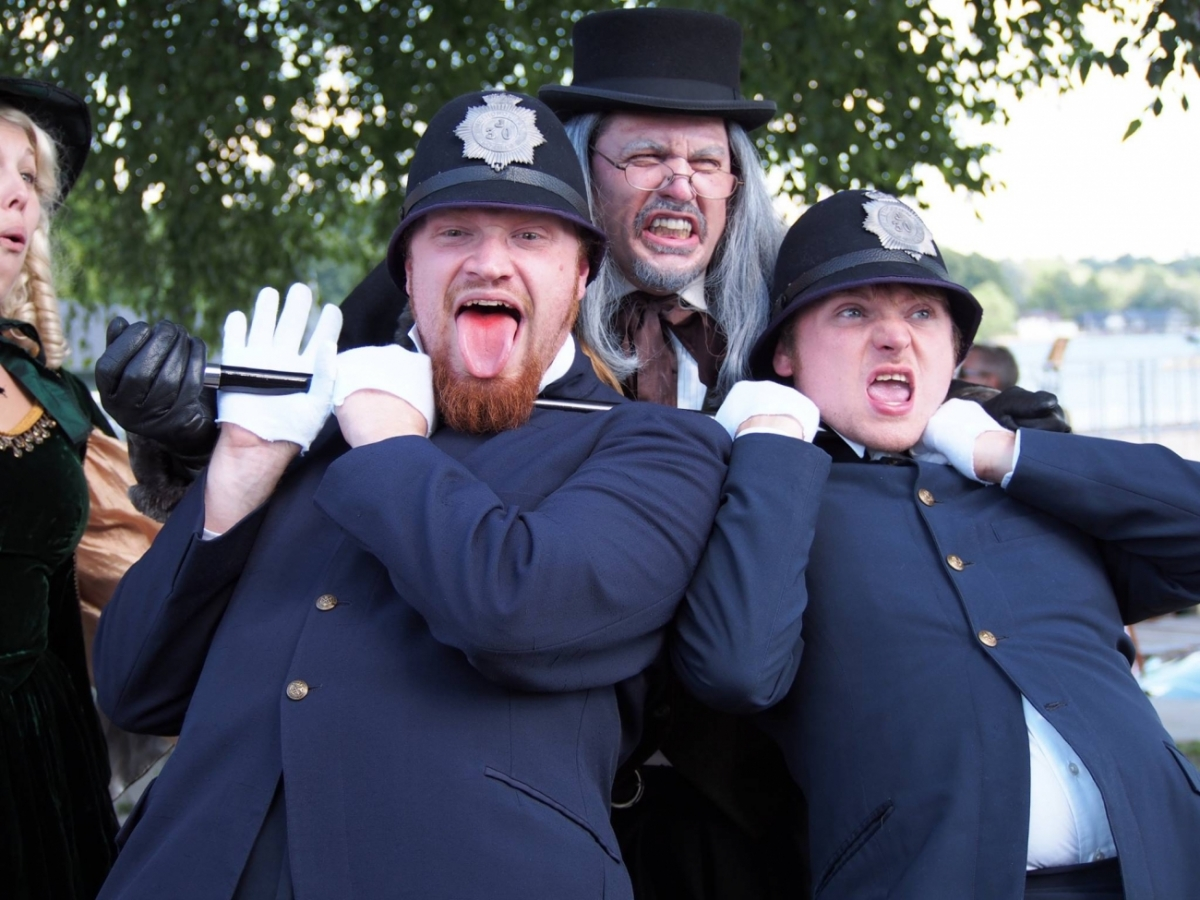 Ebenezer Scrooge character with police officers